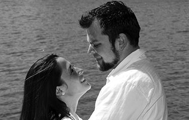 outdoor engagement portrait by lake in Sugar Land Texas